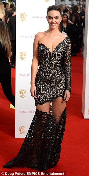 Jennifer Metcalfe Missed the mark wit this giant split dress from Philip Armstrong